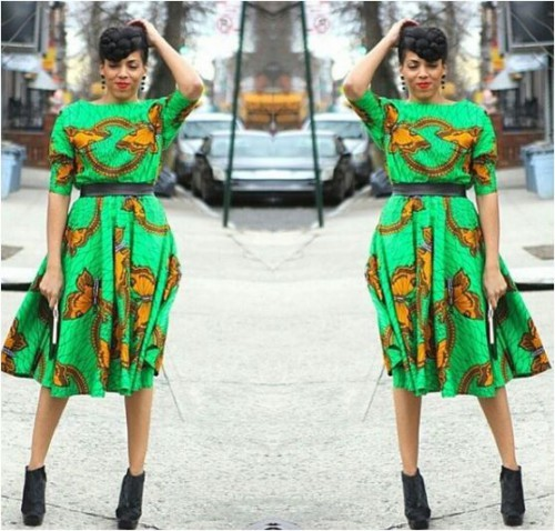 Beautiful lady spotting short flare Ankara gown with cute designs of butterflies. This style is meant to be famzed at.