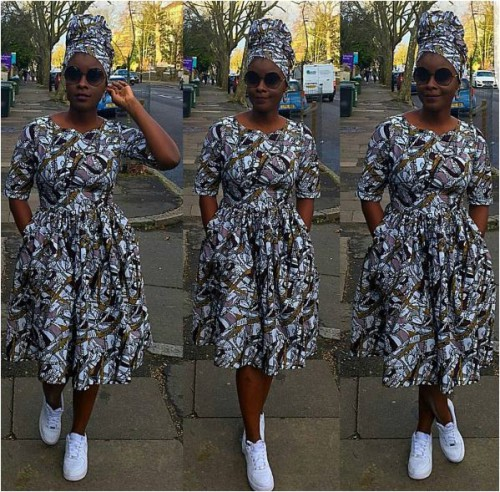 Short flared Ankara dress with sneakers and sun shades to match. Definitely different.